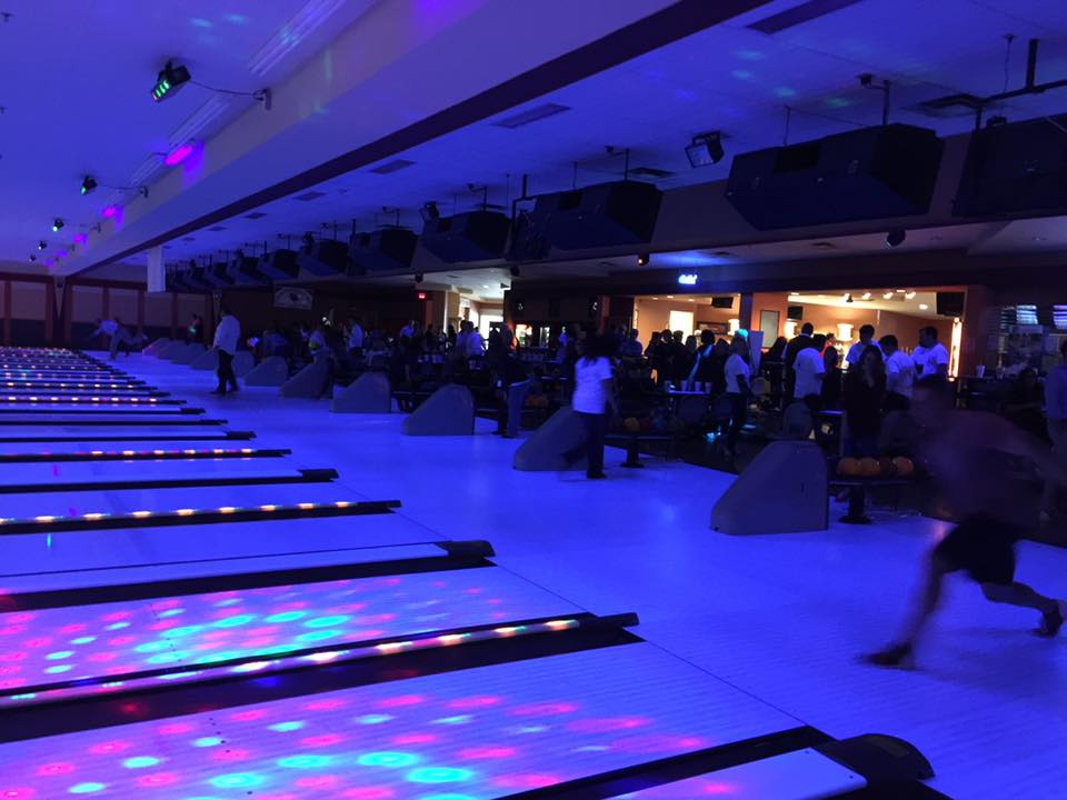 People cosmic bowling